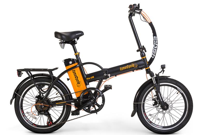 אופניים חשמליים lynxcycle מבית מגנום בצבע שחור כתום