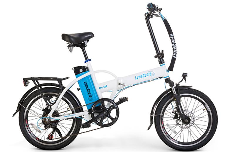 אופניים חשמליים lynxcycle מבית מגנום בצבע לבן תכלת