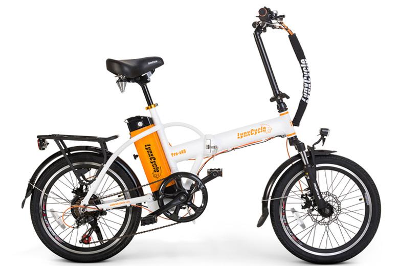 אופניים חשמליים lynxcycle מבית מגנום בצבע לבן כתום
